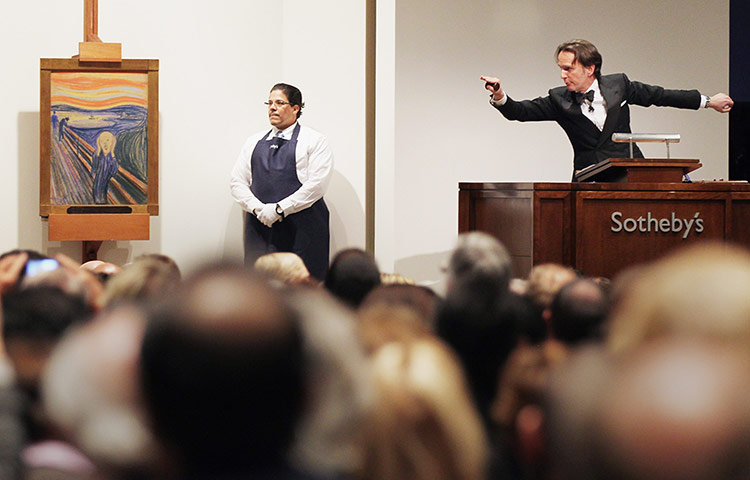 Edvard Munch's The Scream (1895), auctioned at Sotheby's Sales of Impressionist, Modern and Contemporary Art on 2 May 2012 in New York City. The masterpiece is one of four versions created by Munch and the only one that is privately owned. The painting sold for $119,922,500 Photograph: Mario Tama/Getty Images (via The Guardian)
