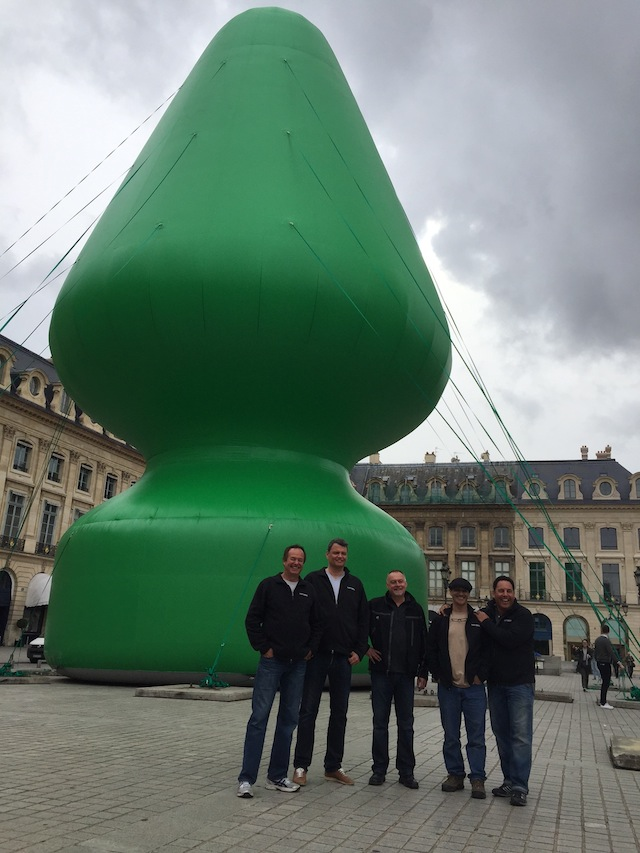 """The Team: """"I am the little guy all the way on the right,"""" says Greg Favish, """"Mark [Bachman] is the taller guy all the way on the left."""" The tree on the Place Vendome was, Bachman says, """"a teaser"""" — in a sense, an advertisement — for Chocolate Factory, 'an installation created by McCarthy for the grand re-opening of la Monnaie de Paris' at FIAC. (all photos courtesy Bigger Than Life unless otherwise noted)"""
